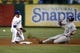 May 7, 2014; Arlington, TX, USA; Colorado Rockies center fielder Drew Stubbs (13) steals second as Texas Rangers second baseman Donnie Murphy (16) is unable to come up with the ball during the fourth inning of a baseball game at Globe Life Park in Arlington. Mandatory Credit: Jim Cowsert-USA TODAY Sports