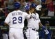 May 7, 2014; Arlington, TX, USA; Texas Rangers third baseman Adrian Beltre (29) is congratulated by Texas Rangers left fielder Michael Choice (15) after hitting a home run against the Colorado Rockies during the sixth inning of a baseball game at Globe Life Park in Arlington. Mandatory Credit: Jim Cowsert-USA TODAY Sports