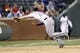 May 7, 2014; Arlington, TX, USA; Colorado Rockies third baseman Nolan Arenado (28) dives and is unable to come up with the ball on a double hit by Texas Rangers shortstop Elvis Andrus (not pictured) during the ninth inning of a baseball game at Globe Life Park in Arlington. The Rockies won 9-2. Mandatory Credit: Jim Cowsert-USA TODAY Sports