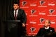 May 9, 2014; Atlanta, GA, USA; Atlanta Falcons first round draft pick tackle Jake Matthews (center) speaks next to team owner Arthur Blank during a press conference at Falcons Training Facility. Mandatory Credit: Dale Zanine-USA TODAY Sports