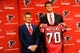 May 9, 2014; Atlanta, GA, USA; Atlanta Falcons general manger Thomas Dimitroff and first round draft pick tackle Jake Matthews (with jersey) shown during a press conference at Falcons Training Facility. Mandatory Credit: Dale Zanine-USA TODAY Sports