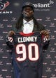 May 9, 2014; Houston, TX, USA; Houston Texans first-round draft pick Jadeveon Clowney poses with his jersey during a press conference at Reliant Stadium. Mandatory Credit: Troy Taormina-USA TODAY Sports