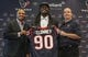 May 9, 2014; Houston, TX, USA; Houston Texans general manager Rick Smith (left) and head coach Bill O'Brien (right) pose for a picture with first-round draft pick Jadeveon Clowney (middle) during a press conference at Reliant Stadium. Mandatory Credit: Troy Taormina-USA TODAY Sports