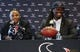 May 9, 2014; Houston, TX, USA; Houston Texans general manager Rick Smith (left) speaks to the media  during a press conference to introduce first-round draft pick Jadeveon Clowney (right) at Reliant Stadium. Mandatory Credit: Troy Taormina-USA TODAY Sports
