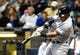May 9, 2014; Milwaukee, WI, USA;  New York Yankees third baseman Yangervis Solarte (26) hits a 3-run home run in the fourth inning against the Milwaukee Brewers at Miller Park. Mandatory Credit: Benny Sieu-USA TODAY Sports