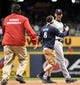 May 9, 2014; Milwaukee, WI, USA;  New York Yankees shortstop Derek Jeter (2) is confronted by a fan in the sixth inning during the game against the Milwaukee Brewers at Miller Park. Mandatory Credit: Benny Sieu-USA TODAY Sports