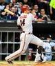 May 9, 2014; Chicago, IL, USA; Arizona Diamondbacks third baseman Martin Prado (14) during the fourth inning at U.S Cellular Field. Mandatory Credit: Mike DiNovo-USA TODAY Sports