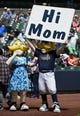 May 11, 2014; Milwaukee, WI, USA; Milwaukee Brewer mascot, Bernie Brewer, holds a sign prior to the game against the New York Yankees at Miller Park. Mandatory Credit: Benny Sieu-USA TODAY Sports
