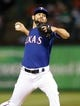 May 8, 2014; Arlington, TX, USA;  Texas Rangers relief pitcher Nick Martinez (22) throws during the game against the Colorado Rockies at Globe Life Park in Arlington. Mandatory Credit: Kevin Jairaj-USA TODAY Sports