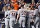 May 13, 2014; Baltimore, MD, USA; Detroit Tigers teammates Miguel Cabrera (far left) and Victor Martinez (41) celebrate after a game against the Baltimore Orioles at Oriole Park at Camden Yards. The Tigers defeated the Orioles 4-1. Mandatory Credit: Joy R. Absalon-USA TODAY Sports