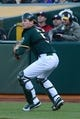 May 10, 2014; Oakland, CA, USA; Oakland Athletics catcher John Jaso (5) throws the baseball to third base against the Washington Nationals during the third inning at O.co Coliseum. The Athletics defeated the Nationals 4-3 in 10 innings. Mandatory Credit: Kyle Terada-USA TODAY Sports