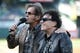 May 10, 2014; Oakland, CA, USA; Musical group Journey keyboardist Jonathan Cain (left) and guitarist Neal Schon (right) talk after performing the national anthem before the game between the Oakland Athletics and the Washington Nationals at O.co Coliseum. The Athletics defeated the Nationals 4-3 in 10 innings. Mandatory Credit: Kyle Terada-USA TODAY Sports