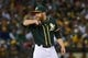 May 10, 2014; Oakland, CA, USA; Oakland Athletics relief pitcher Sean Doolittle (62) looks for the pitch call during the ninth inning against the Washington Nationals at O.co Coliseum. The Athletics defeated the Nationals 4-3 in 10 innings. Mandatory Credit: Kyle Terada-USA TODAY Sports