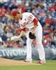 May 17, 2014; Philadelphia, PA, USA; Philadelphia Phillies starting pitcher Cole Hamels (35) picks up the rosin bag during the first inning against the Cincinnati Reds at Citizens Bank Park. The Phillies defeated the Reds, 12-1. Mandatory Credit: Eric Hartline-USA TODAY Sports