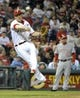 May 17, 2014; Philadelphia, PA, USA; Philadelphia Phillies third baseman Cody Asche (25) throws to first base against the Cincinnati Reds in the sixth inning Citizens Bank Park. The Phillies defeated the Reds, 12-1. Mandatory Credit: Eric Hartline-USA TODAY Sports