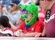 May 18, 2014; Philadelphia, PA, USA; A young fan wears a Philly Phanatic hat and nose in a game against the Cincinnati Reds at Citizens Bank Park. The Phillies won 8-3. Mandatory Credit: Bill Streicher-USA TODAY Sports