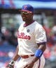 May 18, 2014; Philadelphia, PA, USA; Philadelphia Phillies first baseman Ryan Howard (6) smiles in the direction of the dugout between innings of a game against the Cincinnati Reds at Citizens Bank Park. The Phillies won 8-3. Mandatory Credit: Bill Streicher-USA TODAY Sports