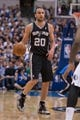 Apr 10, 2014; Dallas, TX, USA; San Antonio Spurs guard Manu Ginobili (20) during the game against the Dallas Mavericks at the American Airlines Center. The Spurs defeated the Mavericks 109-100. Mandatory Credit: Jerome Miron-USA TODAY Sports
