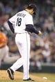 May 25, 2014; Seattle, WA, USA; Seattle Mariners pitcher Hisashi Iwakuma (18) walks around the mound after surrendering a two-run homer to Houston Astros first baseman Marc Krauss (18) during the seventh inning at Safeco Field. Mandatory Credit: Joe Nicholson-USA TODAY Sports