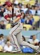April 19, 2014; Los Angeles, CA, USA; Arizona Diamondbacks left fielder Mark Trumbo (15) hits a single in the third inning against the Los Angeles Dodgers at Dodger Stadium. Mandatory Credit: Gary Vasquez-USA TODAY Sports