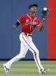 Apr 26, 2014; Atlanta, GA, USA; Atlanta Braves center fielder B.J. Upton (2) catches a fly ball against the Cincinnati Reds in the second inning at Turner Field. Mandatory Credit: Brett Davis-USA TODAY Sports