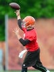 May 28, 2014; Berea, OH, USA; Cleveland Browns quarterback Johnny Manziel (2) throws a pass during organized team activities at Cleveland Browns training facility. Mandatory Credit: Andrew Weber-USA TODAY Sports