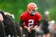 May 28, 2014; Berea, OH, USA; Cleveland Browns quarterback Johnny Manziel (2) hands the ball off during organized team activities at Cleveland Browns training facility. Mandatory Credit: Andrew Weber-USA TODAY Sports