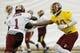May 29, 2014; Ashburn, VA, USA; Washington Redskins quarterback Robert Griffin III (10) hands the ball off to Washington Redskins wide receiver DeSean Jackson (1) during organized team activities at Redskins Park. Mandatory Credit: Geoff Burke-USA TODAY Sports