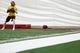 May 29, 2014; Ashburn, VA, USA; Washington Redskins quarterback Robert Griffin III (10) prepares to throw the ball during organized team activities at Redskins Park. Mandatory Credit: Geoff Burke-USA TODAY Sports