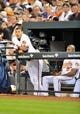 May 12, 2014; Baltimore, MD, USA; Baltimore Orioles third baseman Manny Machado (13) watches the action from the dugout during the third inning against the Detroit Tigers at Oriole Park at Camden Yards. The Tigers defeated the Orioles 4-1. Mandatory Credit: Joy R. Absalon-USA TODAY Sports