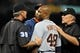 May 12, 2014; Baltimore, MD, USA; MLB umpire Paul Nauert (39) tries to calm Detroit Tigers right fielder Torii Hunter (48) after Hunter was hit by a pitch in the eighth inning against the Baltimore Orioles at Oriole Park at Camden Yards. The Tigers defeated the Orioles 4-1. Mandatory Credit: Joy R. Absalon-USA TODAY Sports