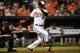 May 12, 2014; Baltimore, MD, USA; Baltimore Orioles right fielder Nick Markakis (21) bats in the seventh inning against the Detroit Tigers at Oriole Park at Camden Yards. The Tigers defeated the Orioles 4-1. Mandatory Credit: Joy R. Absalon-USA TODAY Sports