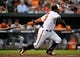 May 12, 2014; Baltimore, MD, USA; Baltimore Orioles center fielder Adam Jones (10) bats in the first inning against the Detroit Tigers at Oriole Park at Camden Yards. The Tigers defeated the Orioles 4-1. Mandatory Credit: Joy R. Absalon-USA TODAY Sports