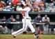 May 14, 2014; Baltimore, MD, USA; Baltimore Orioles third baseman Manny Machado (13) bats in the ninth inning against the Detroit Tigers at Oriole Park at Camden Yards. The Tigers defeated the Orioles 7-5. Mandatory Credit: Joy R. Absalon-USA TODAY Sports
