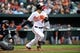 May 14, 2014; Baltimore, MD, USA; Baltimore Orioles right fielder Nick Markakis (21) bats in the eighth inning against the Detroit Tigers at Oriole Park at Camden Yards. The Tigers defeated the Orioles 7-5. Mandatory Credit: Joy R. Absalon-USA TODAY Sports