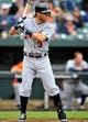 May 14, 2014; Baltimore, MD, USA; Detroit Tigers second baseman Ian Kinsler (3) bats in the first inning against the Baltimore Orioles at Oriole Park at Camden Yards. The Tigers defeated the Orioles 7-5. Mandatory Credit: Joy R. Absalon-USA TODAY Sports