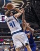 Apr 12, 2014; Dallas, TX, USA; Dallas Mavericks forward Dirk Nowitzki (41) and Phoenix Suns forward Channing Frye (8) during the game at the American Airlines Center. The Mavericks defeated the Suns 101-98. Mandatory Credit: Jerome Miron-USA TODAY Sports