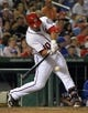 May 30, 2014; Washington, DC, USA; Washington Nationals catcher Wilson Ramos (40) hits a two-run single during the seventh inning at Nationals Park. Washington Nationals defeated the Texas Rangers 9-2. Mandatory Credit: Tommy Gilligan-USA TODAY Sports