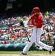 May 31, 2014; Washington, DC, USA; Washington Nationals first baseman Adam LaRoche (25) singles against the Texas Rangers during the first inning at Nationals Park. Mandatory Credit: Brad Mills-USA TODAY Sports