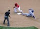 May 31, 2014; Washington, DC, USA; Texas Rangers shortstop Elvis Andrus (1) slides in to second for a double beating the tag by Washington Nationals second baseman Danny Espinosa (8) during the fourth inning at Nationals Park. Mandatory Credit: Brad Mills-USA TODAY Sports