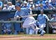 May 28, 2014; Kansas City, MO, USA; Kansas City Royals right fielder Nori Aoki (23) heads down the first base line after a bunt against the Houston Astros during the first inning at Kauffman Stadium. Mandatory Credit: Peter G. Aiken-USA TODAY Sports