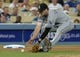 Jun 3, 2014; Los Angeles, CA, USA; Chicago White Sox third baseman Conor Gillaspie (12) makes an out in the eighth inning of the game against the Los Angeles Dodgers at Dodger Stadium. White Sox won 4-1. Mandatory Credit: Jayne Kamin-Oncea-USA TODAY Sports