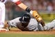 Jun 6, 2014; Anaheim, CA, USA; Chicago White Sox left fielder Alejandro De Aza (30) dives back to first base in the fourth inning of the game against the Los Angeles Angels at Angel Stadium of Anaheim. Mandatory Credit: Jayne Kamin-Oncea-USA TODAY Sports