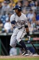 Jun 7, 2014; Pittsburgh, PA, USA; Milwaukee Brewers left fielder Khris Davis (18) singles against the Pittsburgh Pirates during the ninth inning at PNC Park. The Brewers won 9-3. Mandatory Credit: Charles LeClaire-USA TODAY Sports