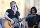 Jun 7, 2014; Pittsburgh, PA, USA;  Performing artists John Rzeznik (left) and Robby Takac (right) of the band Goo Goo Dolls perform during a post-game concert after the Milwaukee Brewers defeated the Pittsburgh Pirates at PNC Park. The Brewers won 9-3. Mandatory Credit: Charles LeClaire-USA TODAY Sports