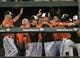 Jun 7, 2014; Baltimore, MD, USA; Baltimore Orioles center fielder Adam Jones (10) is congratulated by teammates after hitting a solo home run in the first inning against the Oakland Athletics at Oriole Park at Camden Yards. Mandatory Credit: Joy R. Absalon-USA TODAY Sports