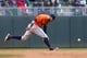 Jun 7, 2014; Minneapolis, MN, USA; Houston Astros second baseman Jose Altuve (27) misses the ground ball against the Minnesota Twins at Target Field. Mandatory Credit: Brad Rempel-USA TODAY Sports