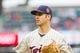 Jun 7, 2014; Minneapolis, MN, USA; Minnesota Twins first baseman Joe Mauer (7) walks back to the dugout against the Houston Astros at Target Field. Mandatory Credit: Brad Rempel-USA TODAY Sports