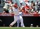June 8, 2014; Anaheim, CA, USA; Los Angeles Angels designated hitter Albert Pujols (5) hits a single in the first inning against the Chicago White Sox at Angel Stadium of Anaheim. Mandatory Credit: Gary A. Vasquez-USA TODAY Sports