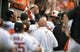 Jun 9, 2014; Baltimore, MD, USA; Baltimore Orioles designated hitter Adam Jones (10) is congratulated by teammates after hitting a solo home run in the first inning against the Boston Red Sox at Oriole Park at Camden Yards. Mandatory Credit: Joy R. Absalon-USA TODAY Sports